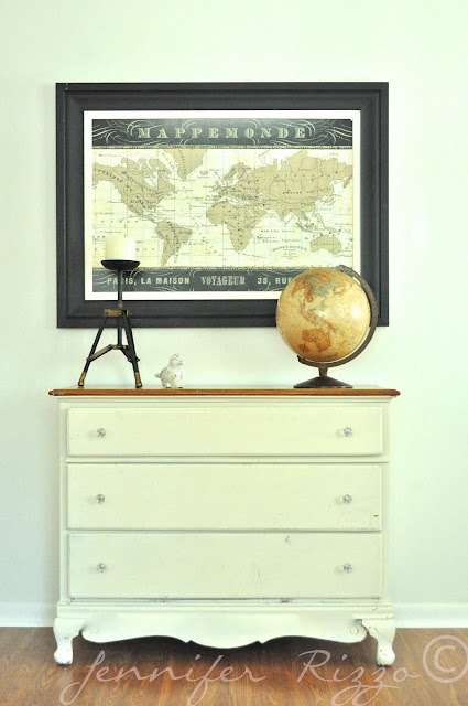 Great vignette with vintage globe and map on old dresser