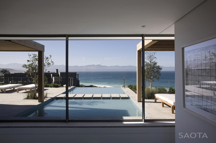 Glass wall and swimming pool in Beautiful Plett 6541+2 Home by SAOTA