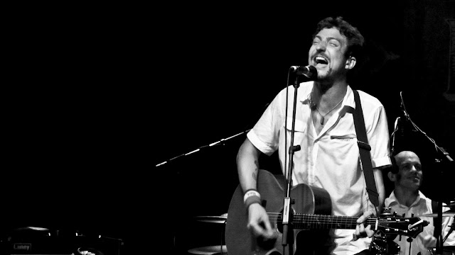 Frank Turner singing on stage at Summit Music Hall in Denver.