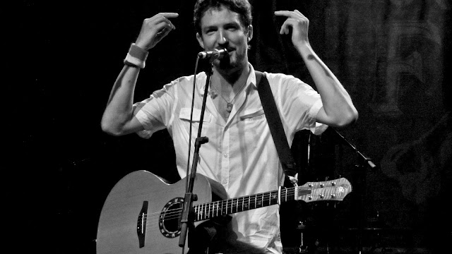 Frank Turner with both middle fingers in the air at Summit Music Hall.