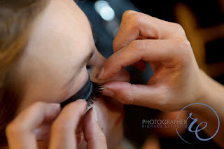 Applying E.Y.E. Lashes at Mercedes-Benz Fashion Week