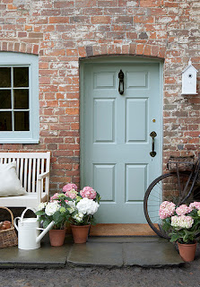 teal and brick front door