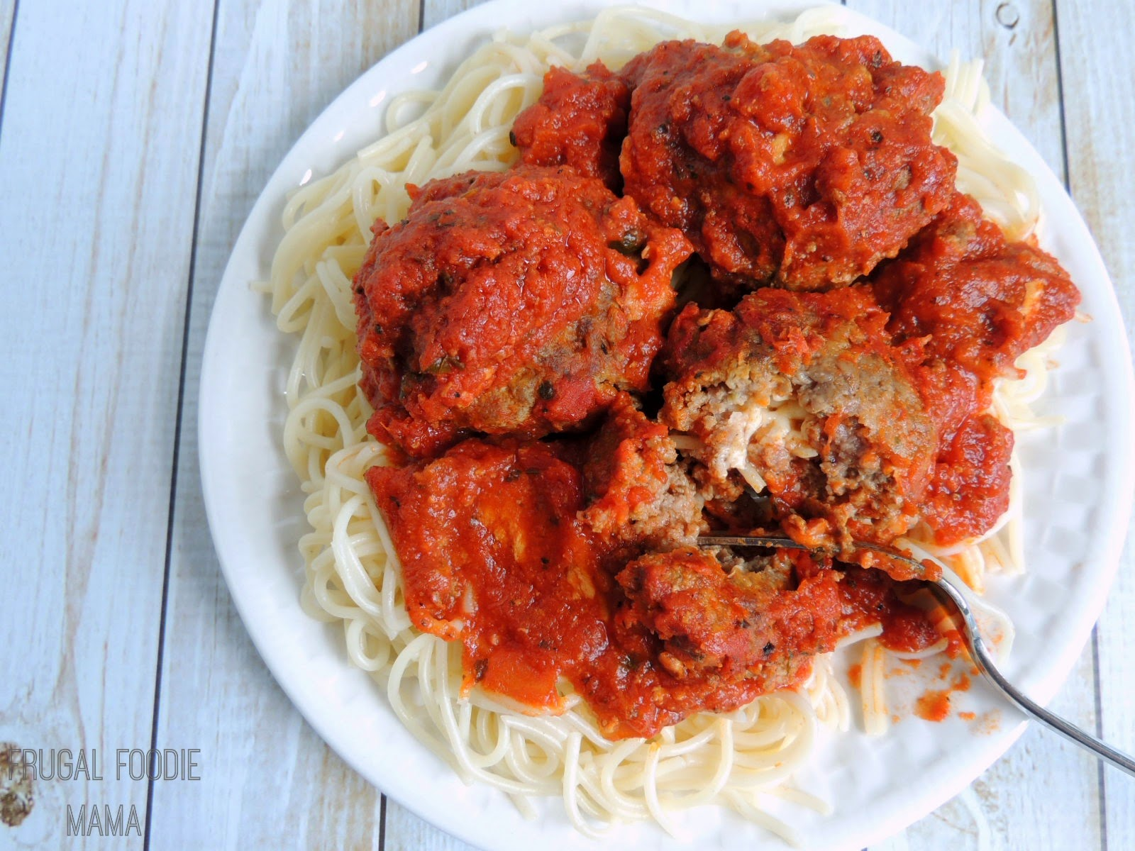 Double Mozzarella Stuffed Meatballs via thefrugalfoodiemama.com #slowcooker