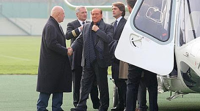Silvio Berlusconi arrives to AC Milan's training camp in Milanello on his helicopter