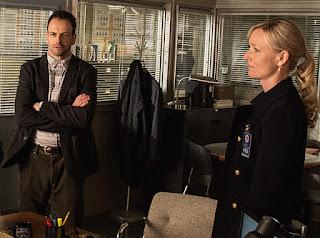 Jonny Lee Miller as Sherlock Holmes Kari Matchett as Kathryn Drummond CBS Elementary Super Bowl episode The Deductionist