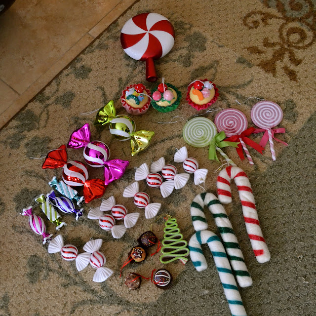 included are pepperminty ornaments and a tree topper whimsical and multicolored fruit tarts wrapped candies lollipops and ginormous candy canes - Candy Christmas Ornaments