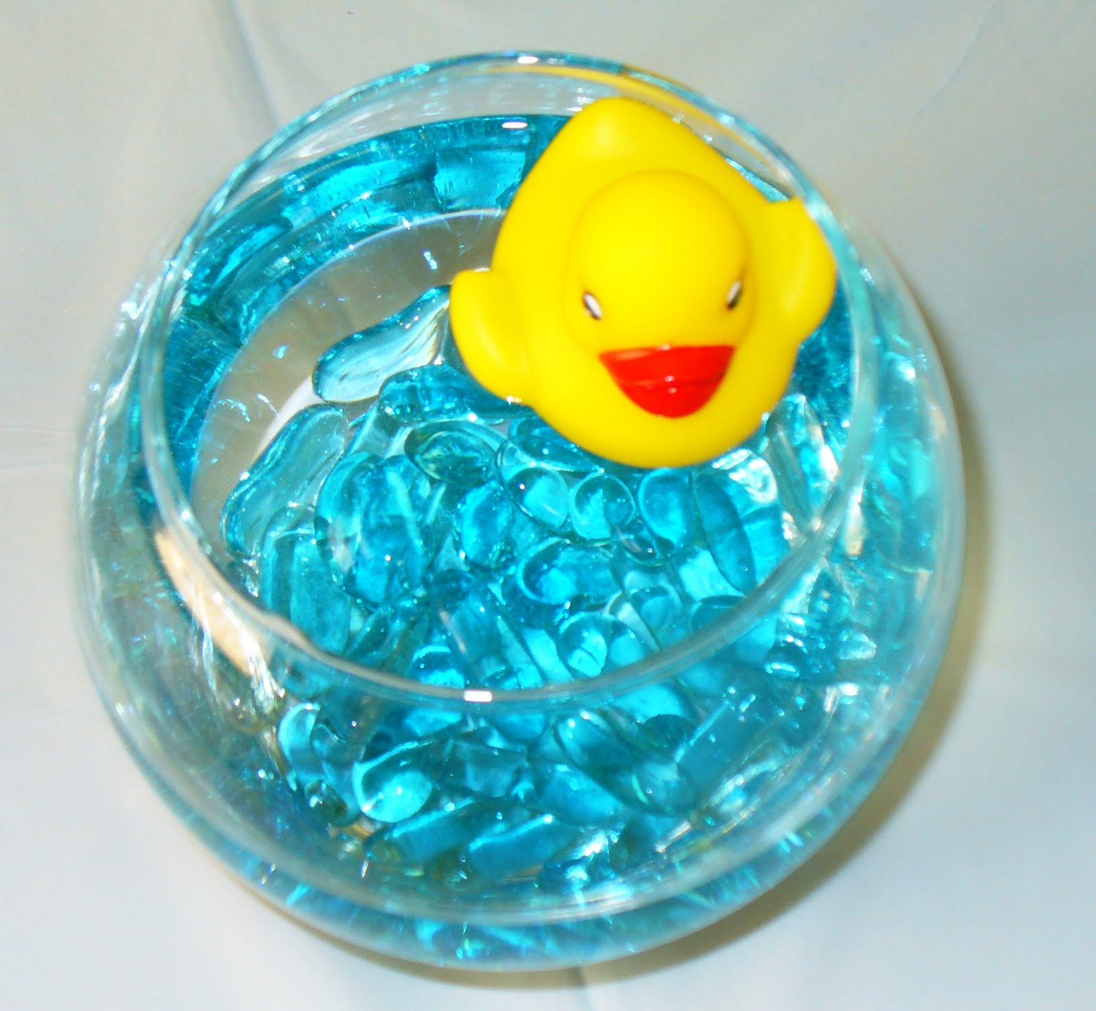 Rubber Duck Baby Shower Centerpieces http://elegantesoirees.blogspot.com/2011/05/rubber-duck-shower-guest-table.html