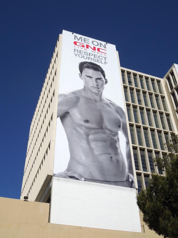 GNC male fitness model billboard