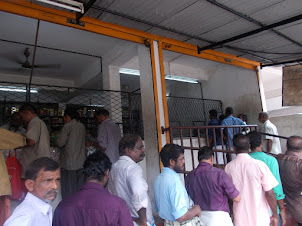 "Queue for purchasing ""LIQUOR"" from registered Govt shop."
