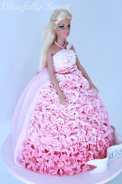 Blissfully Sweet: An Ombre Pink Ruffled Barbie Birthday Cake