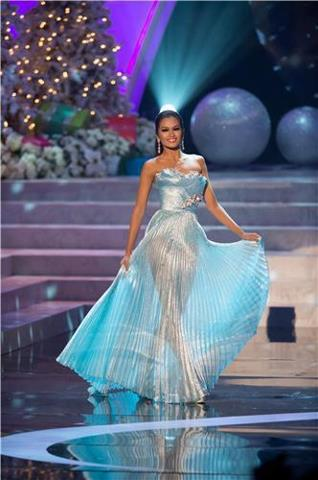 Miss Universe-Philippines Janine Tugonon glides on the runway wearing her evening gown smoothly