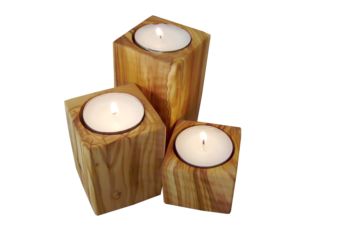 set of 3 Tealight candle holders made of olive tree wood . If I make