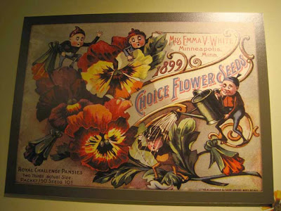 Litho of pansies with pixie figures