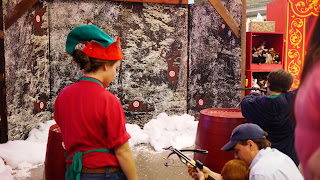 Children shooting toy arrows at Santa Land at Bass Pro Shops