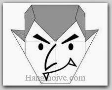 Bước 11: Vẽ mắt, mũi miệng để hoàn thành cách xếp ác quỷ dracula bằng giấy theo phong cách origami.
