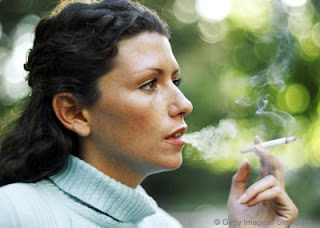 SMOKING 'POSES LARGE RISK TO WOMEN'