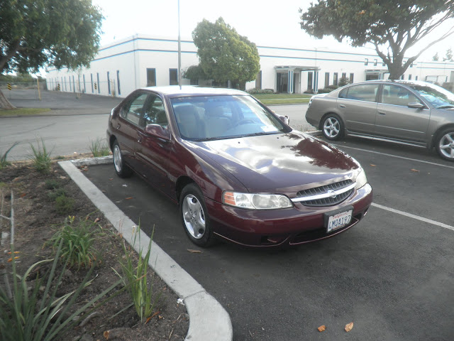 2000 Nissan Altima after complete car painting at Almost Everything Auto Body