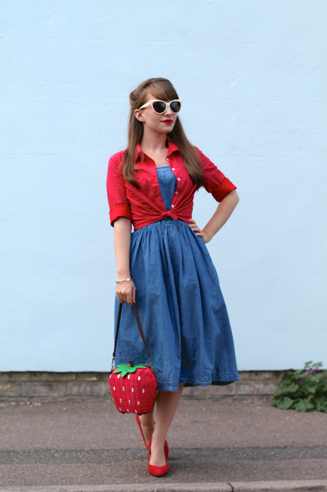 Denim dress, tied shirt and a strawberry wicker bag