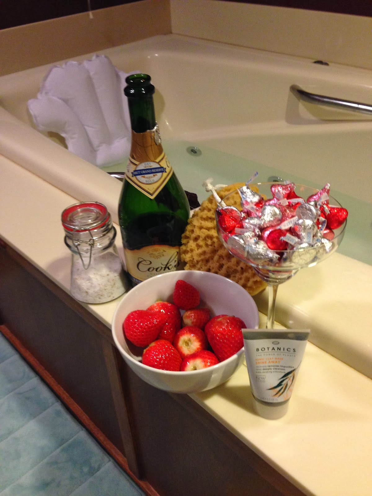 Bath salts, sparkling wine, loofah, dessert, and face mask