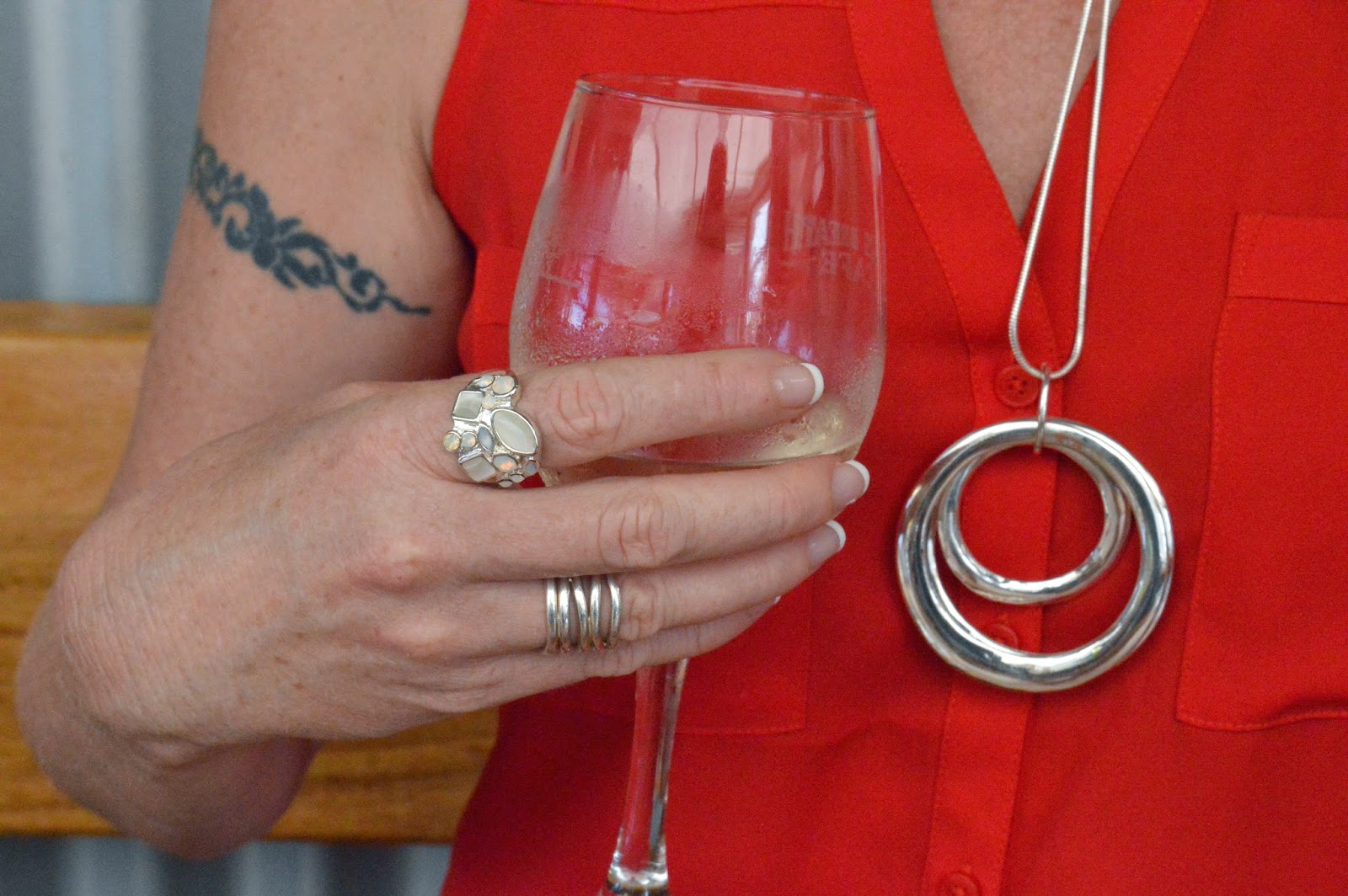 SFH wearing silver rings and Colette necklace.