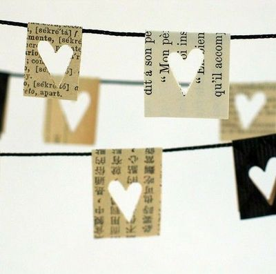 Lovely vintage looking bunting made out of old books with a heart shaped hole punch