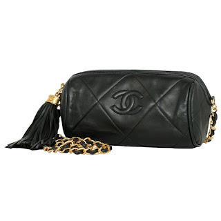 Vintage 1990's black Chanel leather tootsie bag with tassel and gold chain strap.