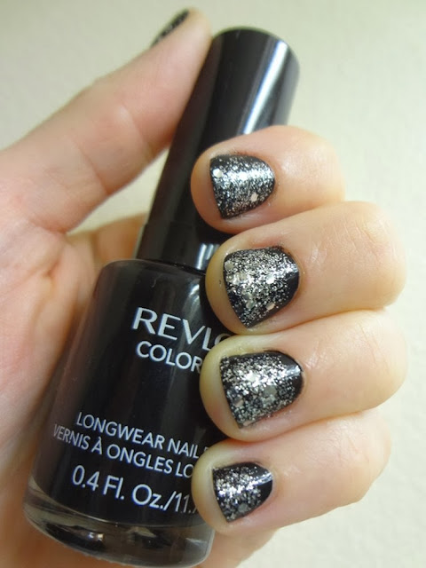 Black nail polish with silver glitter, perfect for New Year's Eve!