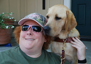 Laura Ann Grymes hugs her guide dog Dyson