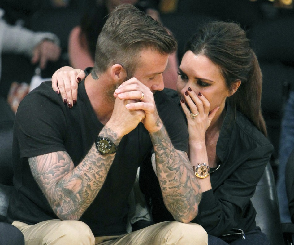 Football: David Beckham With His Wife Victoria Beckham 2013