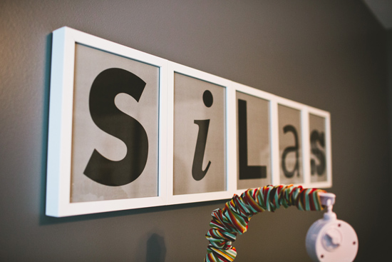 Dancing Commas | Silas' Nursery: Name art above crib