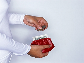 A woman counting her money from her purse