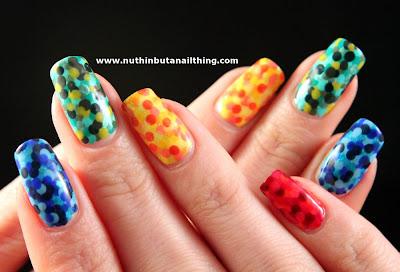 Rainbow polka dot manicure nail art