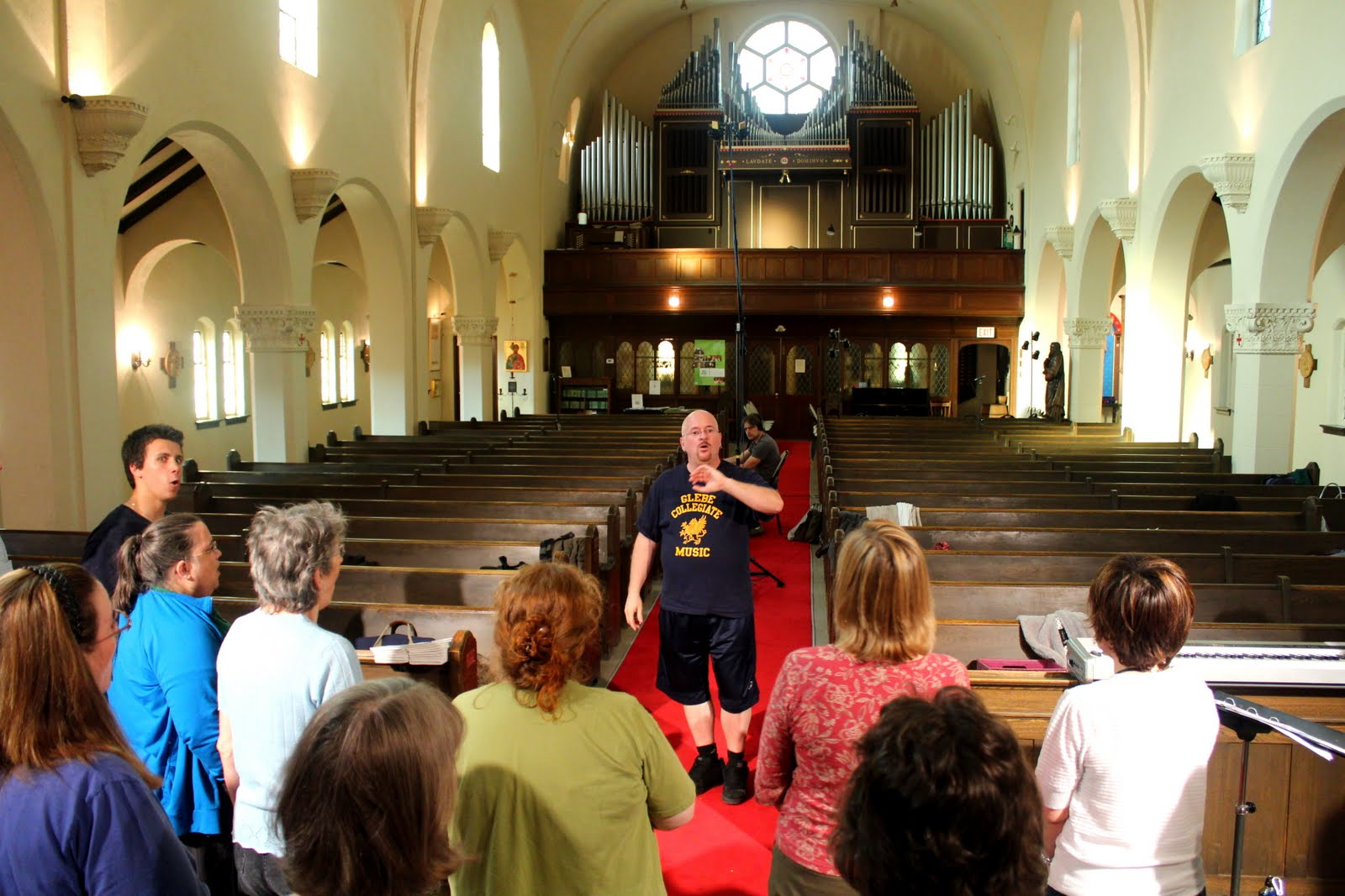 Pierre directs the choir at 2012 Cantate Domino recording session