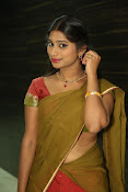 Midhuna latest sizzling pics in half saree-thumbnail-19
