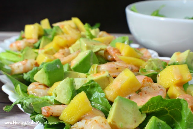 An easy and quick meal that can easily become a favorite. A quick fix recipe for shrimp, layered with mango and avocado on a bed of lettuce and drizzled with a caesar dressing and buffalo sauce mix.