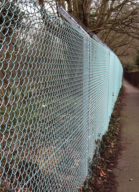 Mesh fence on the Hayes to West Wickham railway path. March 2011.
