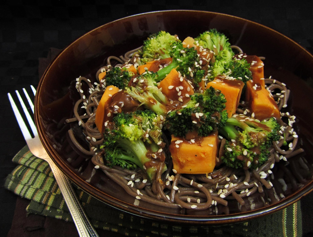 sesame soy broccoli and sweet potatoes on soba noodles