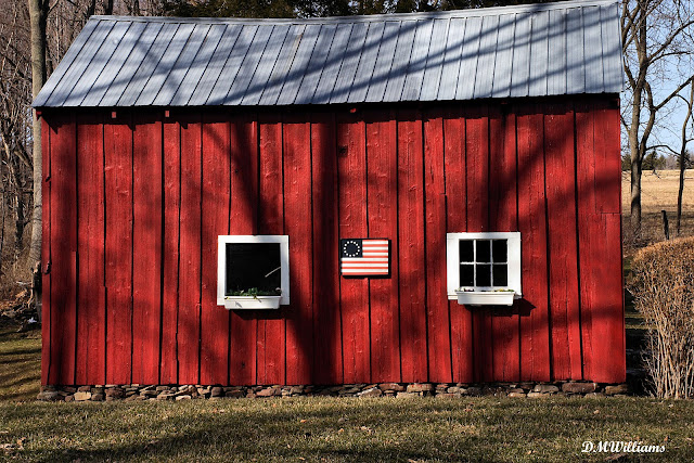 Little red barn with flag
