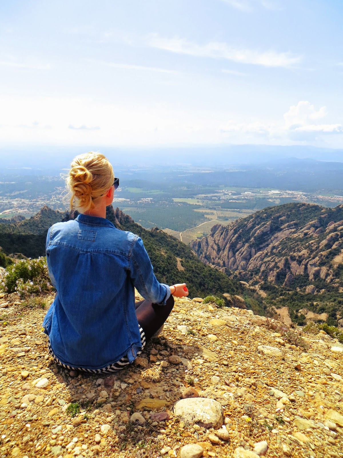 meditate, yoga, mountain top, scenic view, hair styles, three bun hair style, denim shirt, striped shorts, shorts with tights, style blogger, travel blogger, montserrat, spain