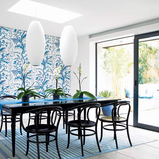 Modern dining room design with blue interior and unique chandelier