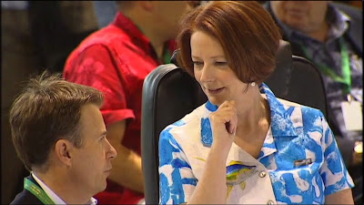 Australian Prime Minister, Julia Gillard, at a Pacific conference with aide