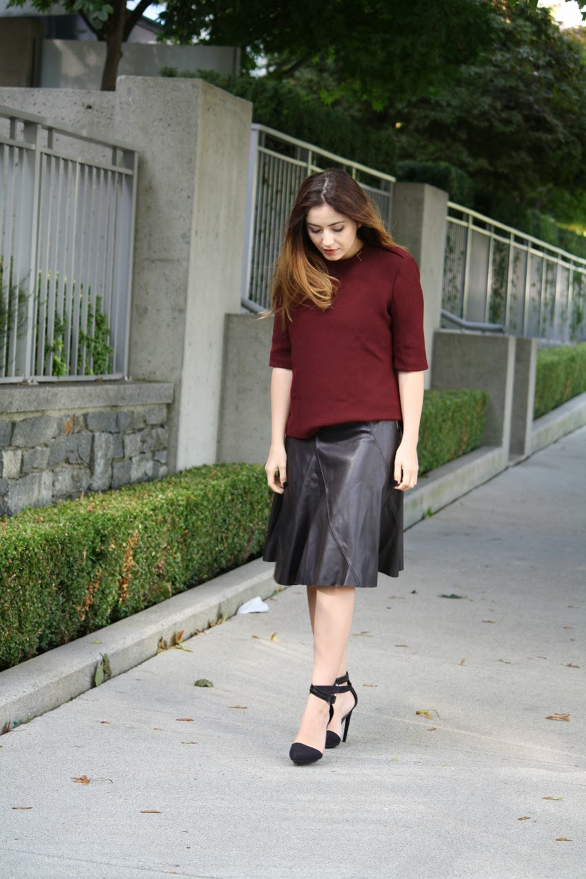 fashion blog street style wearing burgundy top, midi leather skirt, nastygal heels