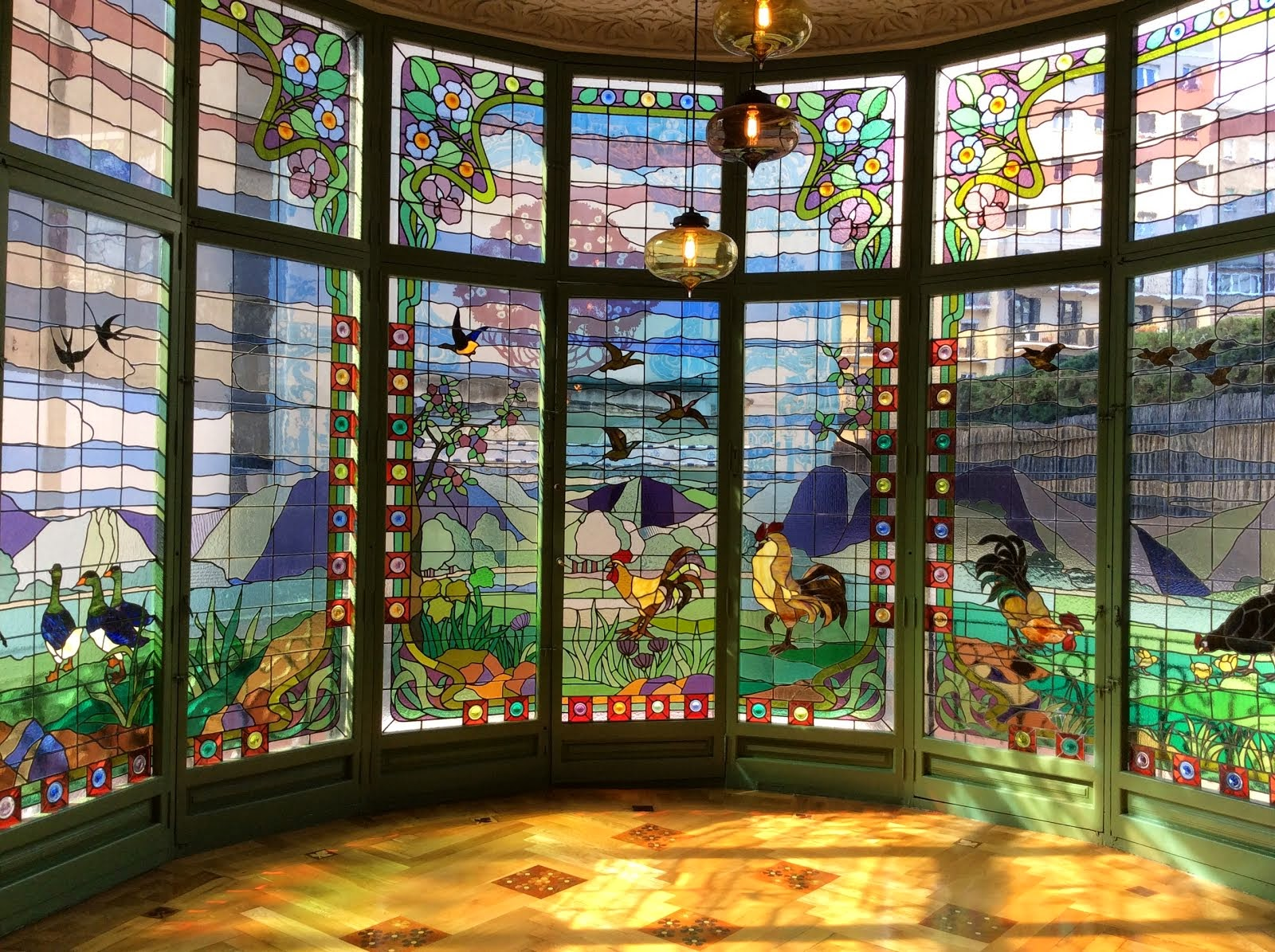 Casa Lleo Morera, Barcelona. Stain glass windows in dining room.