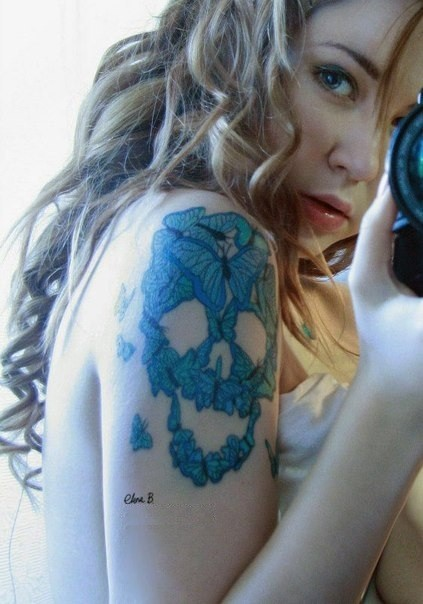 Lovely skull of blue butterflies tattoo on shoulder for girls