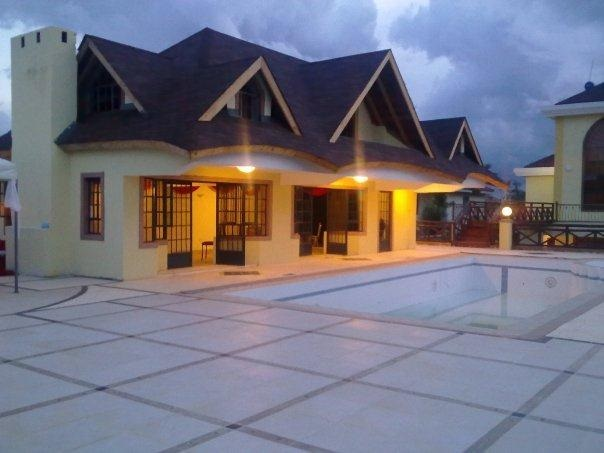 Here are 12 PHOTOs!! JCC's Pastor KIUNA's million dollar home in