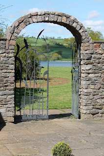 Stone arch, gate and lake
