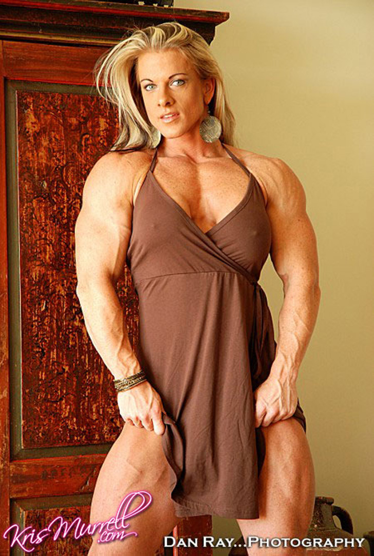 Kris Murrell Modeling Her Built Physique In A Brown Dress