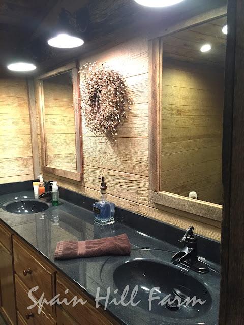beautiful barnwood bathroom with reclaimed barn door