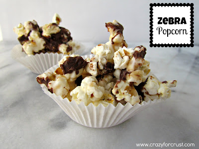 Zebra popcorn in a white cupcake liner with title