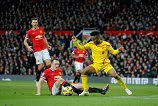 Liverpool's Raheem Sterling (right) finds no way  past Manchester United's Phil Jones